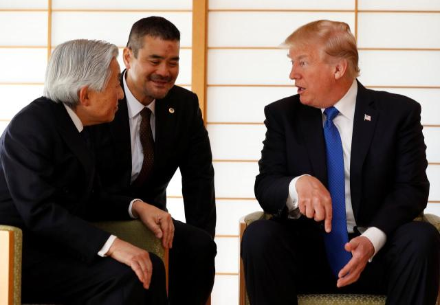 U.S. President Donald Trump talks with Japan's Emperor Akihito during their meeting at the Imperial Palace in Tokyo