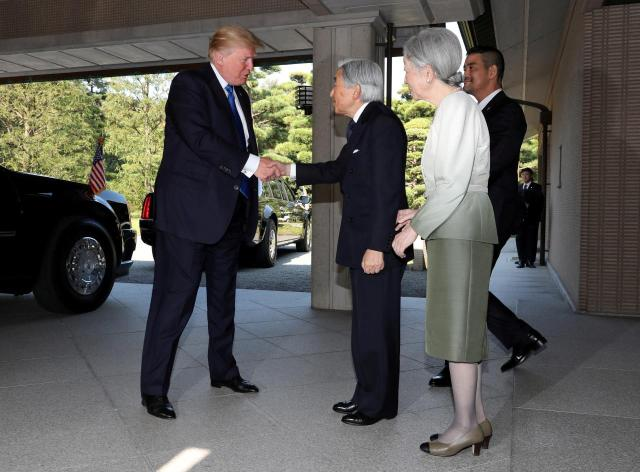 FILE PHOTO: U.S. President Donald Trump, left, and  Emperor Akihito, center, as Empress Michiko looks on at the Imperial Palace in Tokyoo